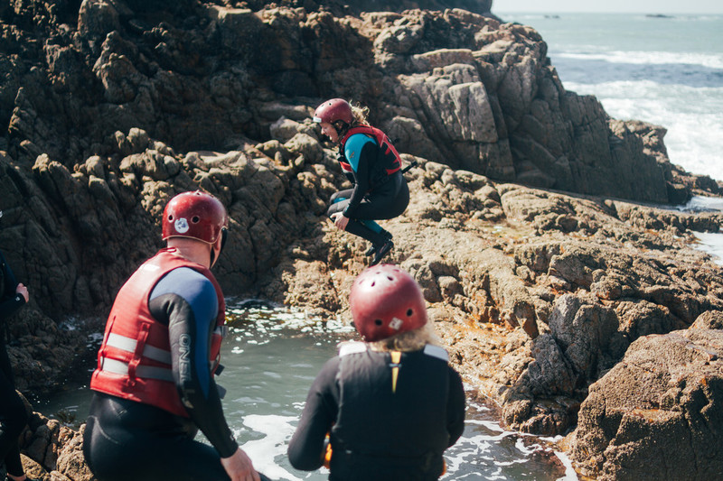 Taking the plunge during a south coast coasteering trip!
